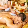 Man getting herbal ball massage treatments . — Stock Photo #44263741