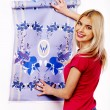 Happy woman glues wallpaper . — Stock Photo