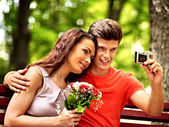 Couple   with camera take pictures — Stock Photo