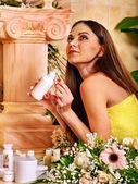 Woman applying moisturizer. — Stock Photo