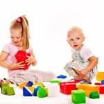 Children play building blocks. — Stock Photo #44648091