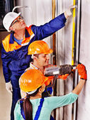 Men in builder uniform. — Stockfoto