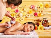 Woman getting herbal ball massage. — Stock Photo