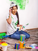 Woman paint wall at home. — Foto Stock