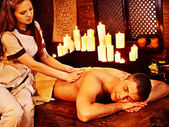 Man having Ayurvedic spa treatment. — Stock Photo