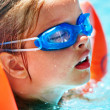 Kids with goggles in swimming pool. — Stock Photo #46650665