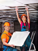 People  installing suspended ceiling — Stock Photo