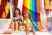 Family  in bikini sliding water park. — Stock Photo