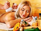 Woman getting herbal ball massage  . — Stock Photo