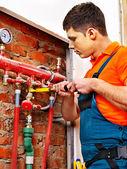 Men builder fixing heating system . — Stock Photo