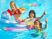 Family in swimming pool. — Stock Photo