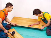 Men laying parquet at home — Stock Photo