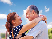 Old couple at summer outdoor. — Stock Photo