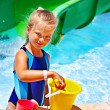 Child with bucket in swimming pool. — Stock Photo #46954381
