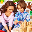 Family with child playing bricks. — Stock Photo #46954537