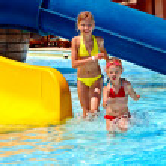 Постер, плакат: Children on water slide at aquapark