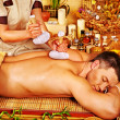 Man getting herbal ball massage treatments . — Stock Photo #46954825