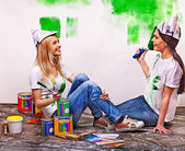 Women paint wall at home. — ストック写真