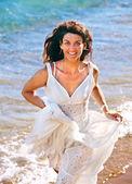 Woman running on beach. — Stock Photo
