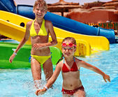 Children on water slide at aquapark. — Stock Photo