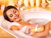 Woman takes bubble  bath. — Stock Photo