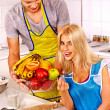 Young family cooking at kitchen. — Stock Photo #47344273