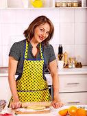 Woman knead dough at kitchen. — Stock Photo