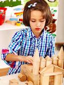 Child playing bricks. — Stock Photo