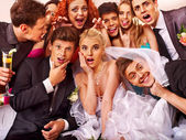 Bride and groom in photobooth. — Stock Photo