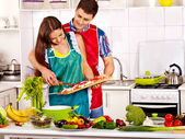 Couple cooking at kitchen. — Foto de Stock