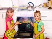Children cooking chicken at kitchen. — Stock Photo