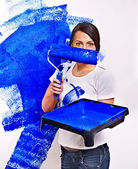 Woman holding roller with blue paint. — Foto de Stock