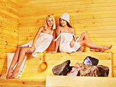 Two girls relaxing in sauna. — ストック写真