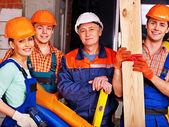 Skupina lidí v uniformě tvůrce. — Stock fotografie