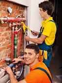 Repairmеn fixing heating system . — Stok fotoğraf