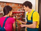 Repairmen fixing heating system . — Stok fotoğraf