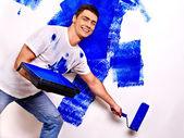 Man paint wall at home. — Stok fotoğraf