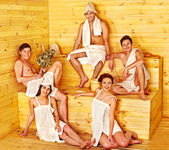 Group of people in Santa hat  at sauna. — ストック写真