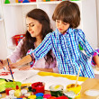 Family with child playing bricks. — Stock Photo #48112489
