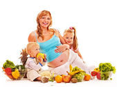 Family pregnant woman preparing food . — Stock Photo