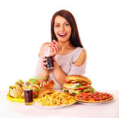 Woman eating fast food. — Stock Photo