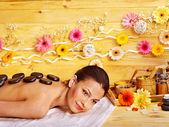 Woman getting stone therapy massage . — Foto Stock