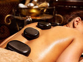 Woman having Ayurvedic stone massage. — Stock Photo