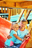Children move out to slide in playground — Stock Photo