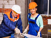 Builder cutting ceramic tile. — Stock Photo