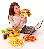 Woman eating junk food. — Foto de Stock