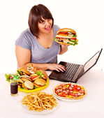 Woman eating junk food. — Stok fotoğraf