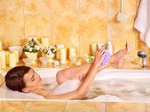 Woman wash leg in bathtube. — Stock Photo