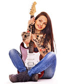 Girl with tattoo playing guitar. — Stock Photo