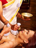Woman having massage with pouch of rice. — Stock Photo